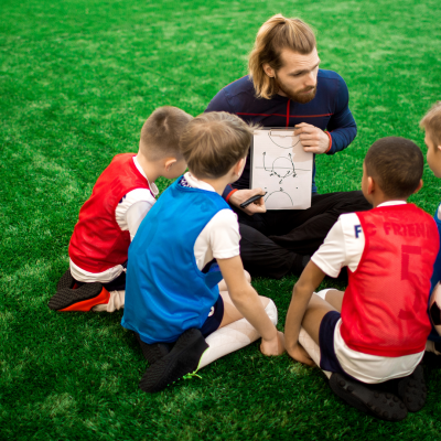The teaching styles of a youth football coach